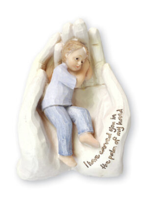 A statue of a child resting on two hands.
