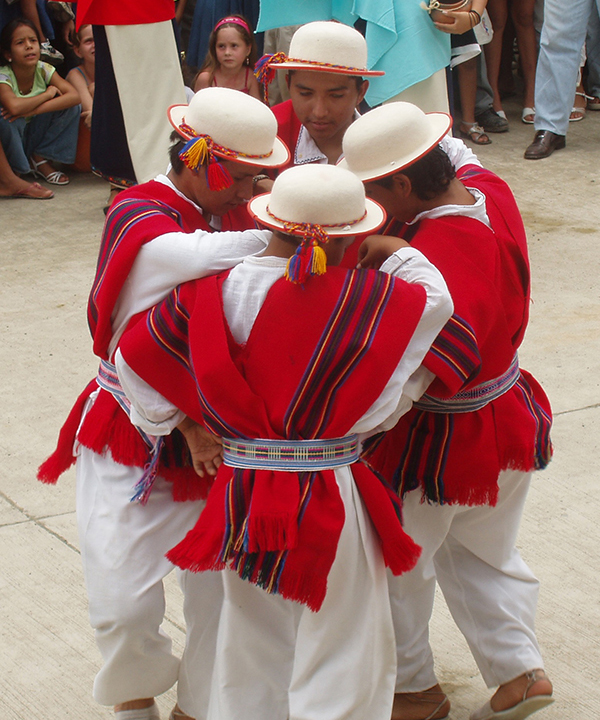 Four people dancing in Ecuador