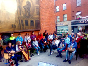 Musicians playing at a fleadh