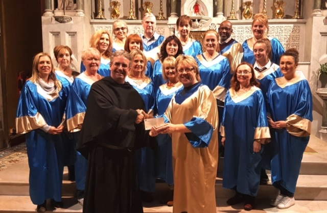 Fr. Colm pictured with a choir