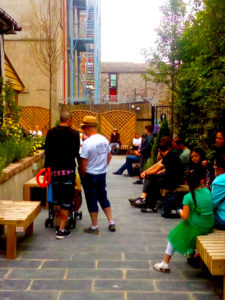 People in a garden for music and poetry