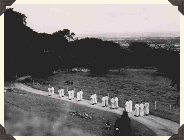 Augustinians walking in file down the driveway to Orlagh.