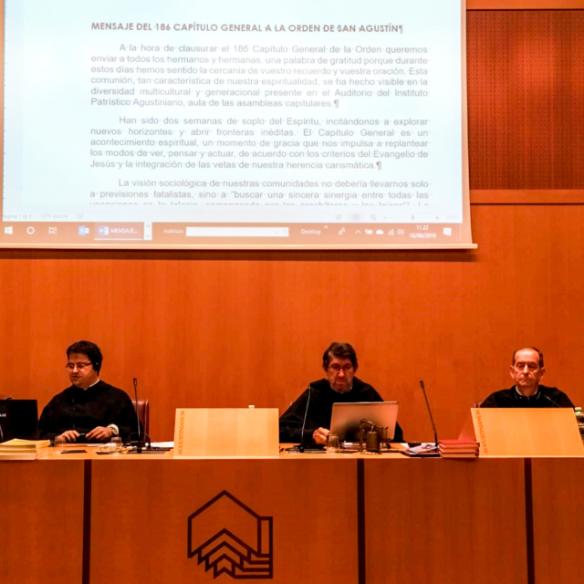 Three Augustinians sitting at the top table in the General Chapter in Rome.