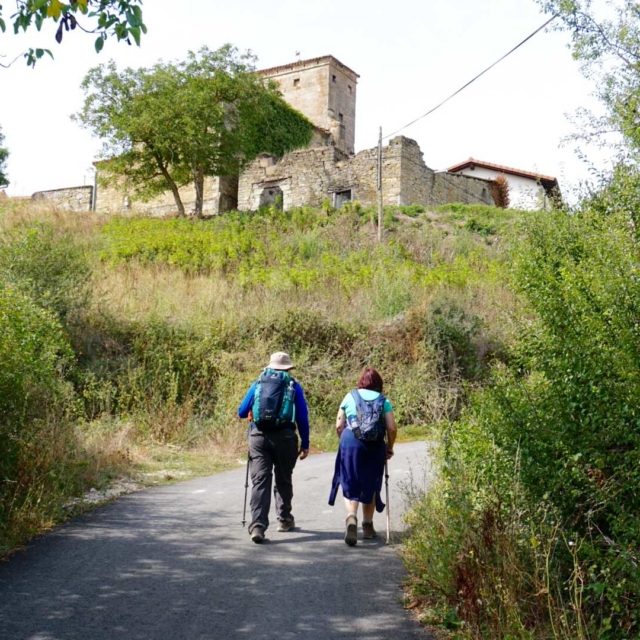 Two people walking the route of the Camino De Santiago.