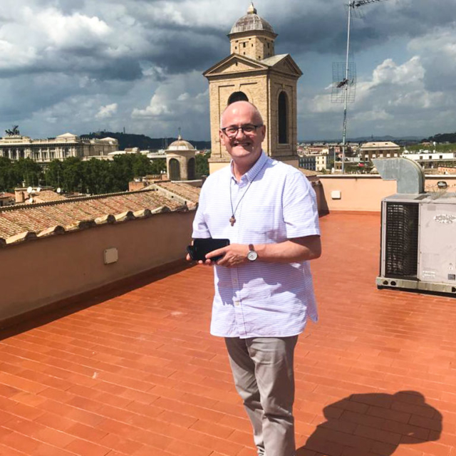 An Augustinian on a roof top over looking Rome.