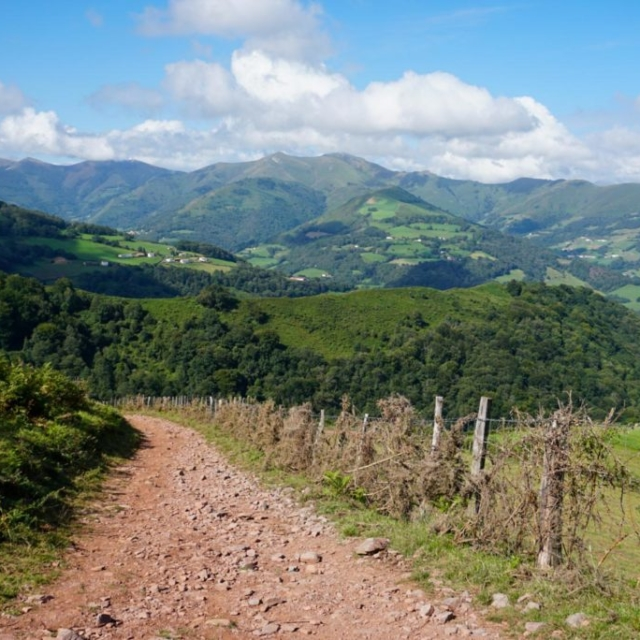 A path on a hill top overlooking mountains along the Camino De Santiago.