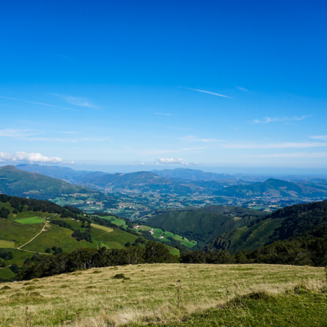 A view from a hill top overlooking a valley along the Camino De Santiago.