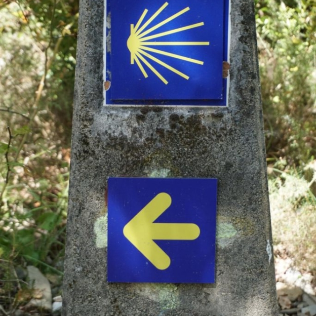 A sign post on a path along the Camino De Santiago.
