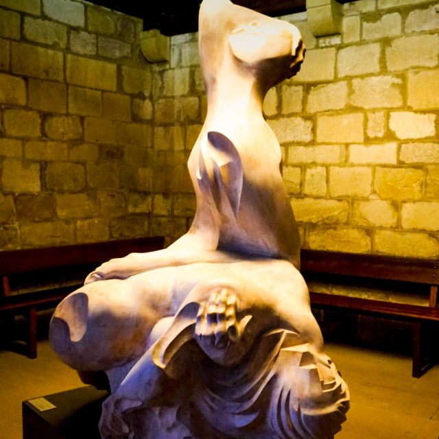 An abstract marble sculpture of a figure.
