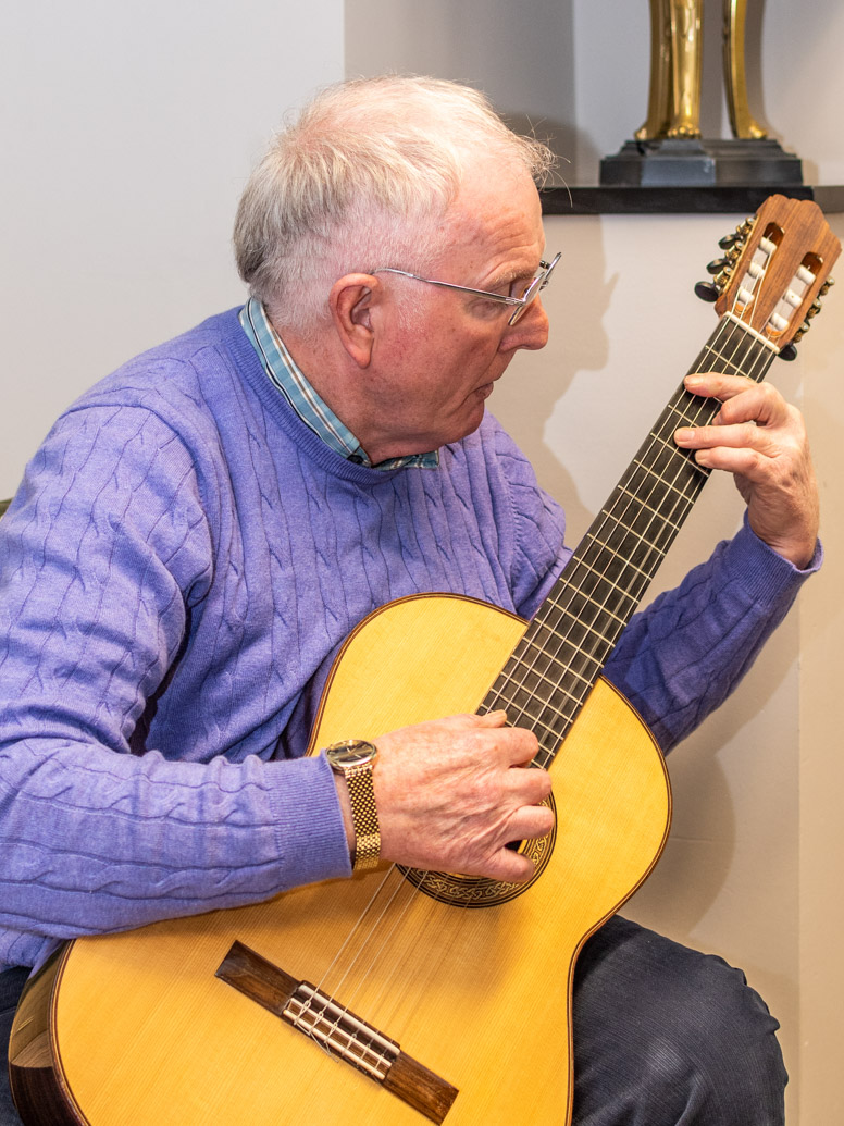 A man playing the guitar at the Augustinian Lay Forum Regional meeting.