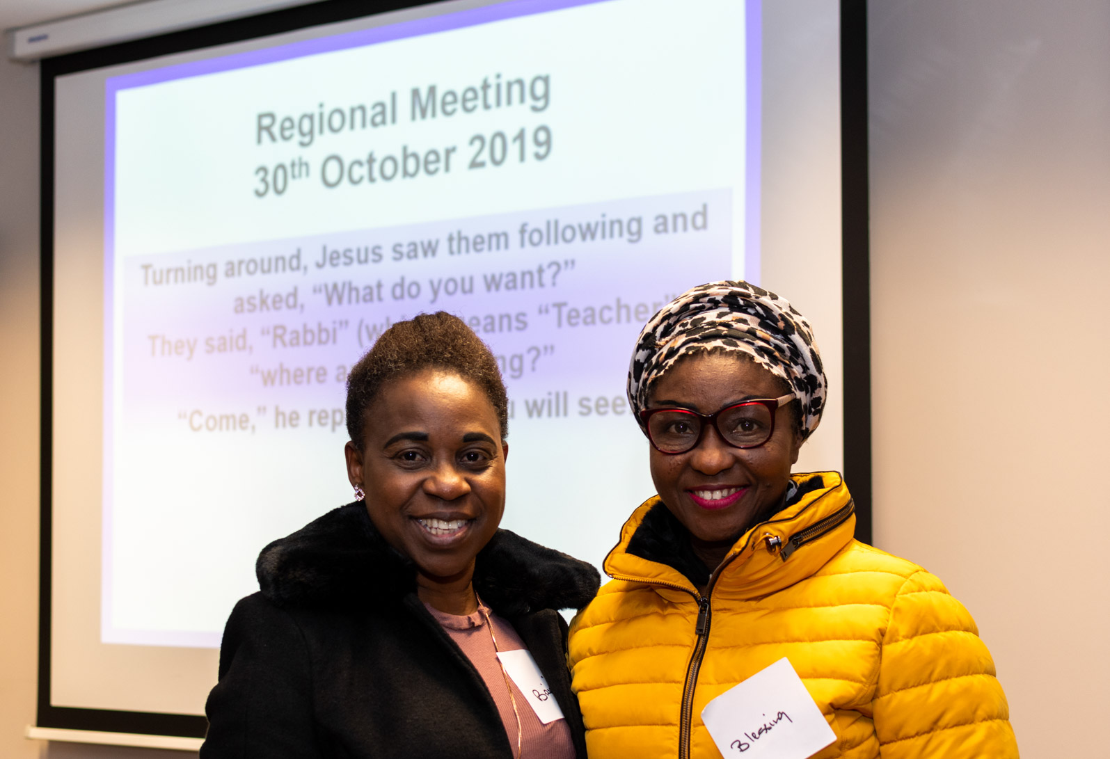 Two ladies smiling for a photo at the Augustinian Lay Forum Regional meeting in Dublin.