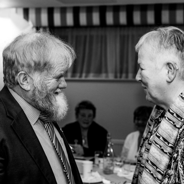 Two Augustinians sharing a laugh and a joke at an event for Lay Augustinians.