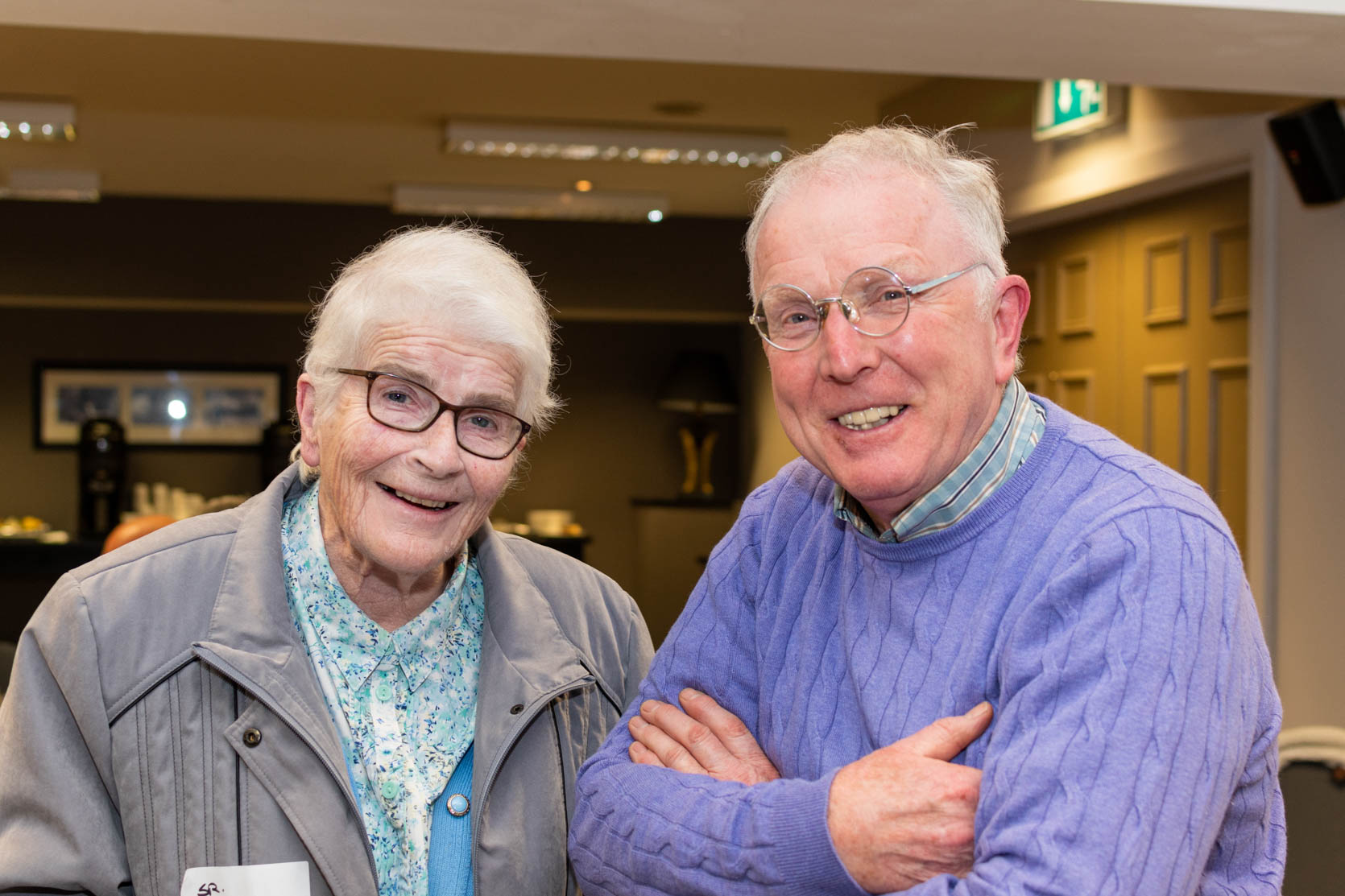 Two Augustinians sharing a smile and posing for a photo at an event for Lay Augustinians.