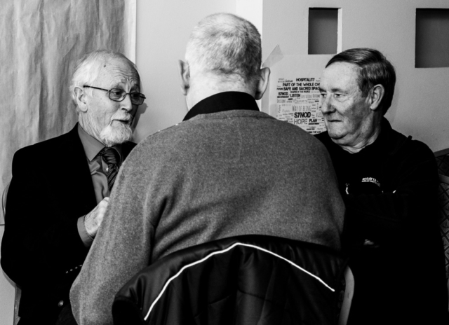 Three Lay Augustinians discussing ideas at the Augustinian Lay Forum Meeting, Limerick.