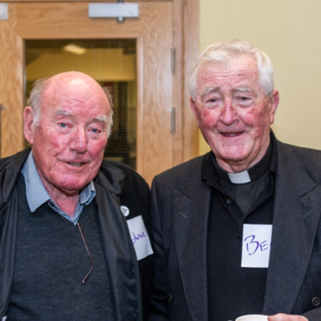 Two people smiling at the Dungarvan Augustinian Lay Forum Meeting.