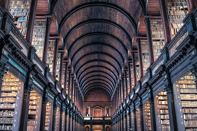 The library of Trinity College with books on shelves.
